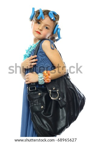 cute little girl posing in a nice dress and handbag - stock photo