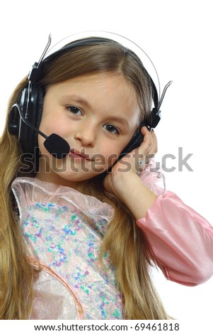 cute little girl posing with headphones - stock photo