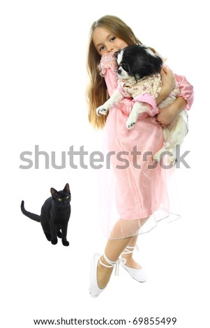 cute little girl posing with pets, isolated on white
