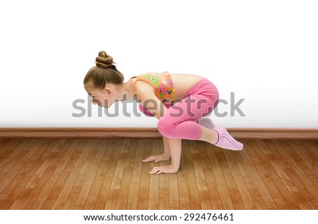 Cute little girl practice yoga - stock photo