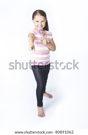Cute little girl practicing being a pop star - stock photo