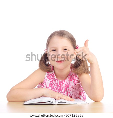 cute little girl reading an interesting book - stock photo