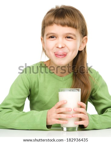 Cute little girl showing milk moustache and thumb up sign, isolated over white - stock photo