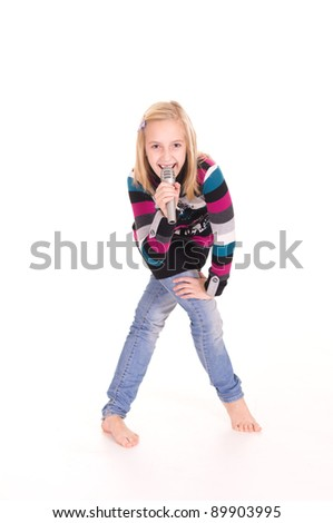 cute little girl singing with microphone on white - stock photo