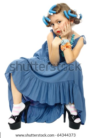 cute little girl sit and posing in a nice dress isolated on white - stock photo