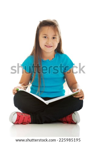 Cute little girl sitting cross legged and learning - stock photo