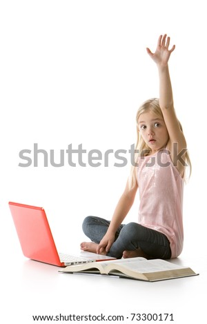 cute little girl sitting down with laptop and book raising her hand isolated on white background - stock photo