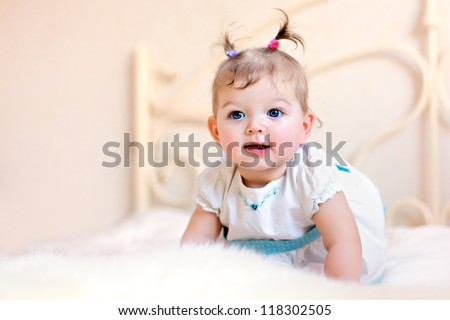 cute little girl sitting on a bed