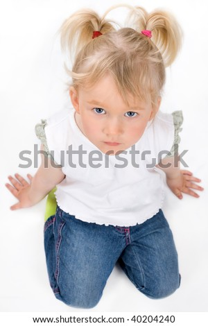 Cute little girl sitting on the floor, isolated on white - stock photo