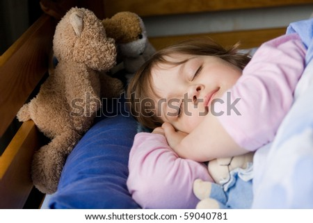 cute, little girl sleeping with teddy bear