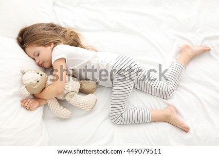 Young teenage girl sleeping naked
