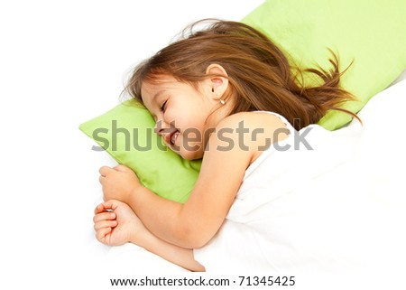 cute little girl smiling in her bed - stock photo