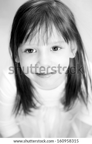 Cute little girl smiling portrait in black and white