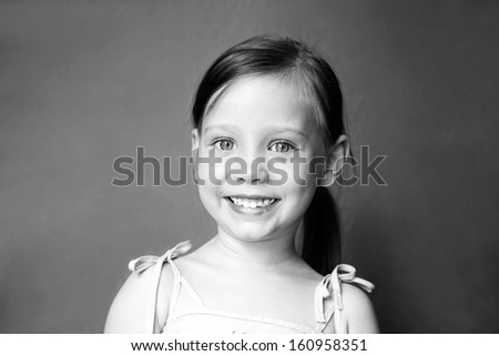 Cute little girl smiling portrait in black and white - stock photo
