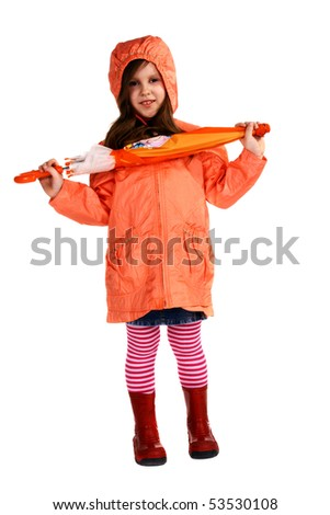 cute little girl standing and holding bright umbrella in her hands