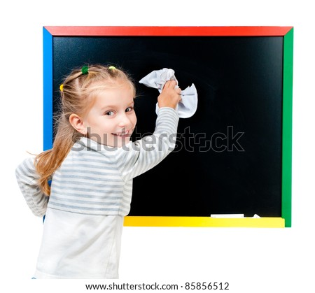 cute little girl standing near blackboard isolated on white - stock photo