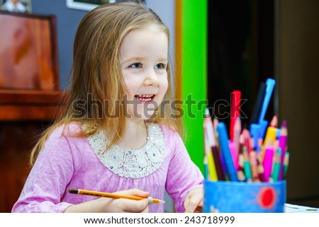 Cute little girl studying to speaking and writing letters at home lesson with her mother - stock photo