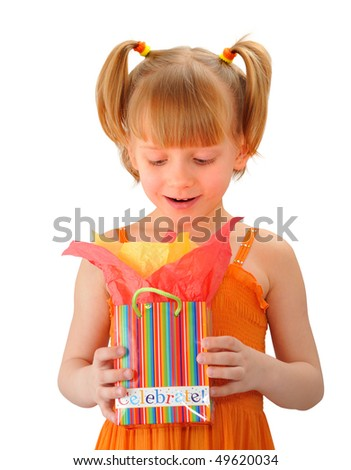 Cute little girl surprised with her present - stock photo