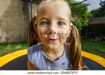 Cute little girl surprising face portrait, close-up - stock photo
