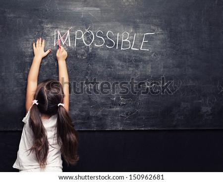 cute little girl thinks everything is possible - stock photo