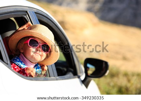cute little girl travel by car in mountains, family vacation