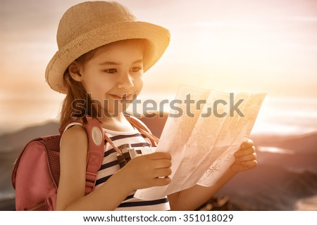 cute little girl travels - stock photo