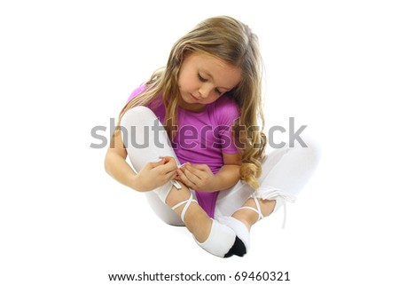 cute little girl tying shoelaces before exercising - stock photo