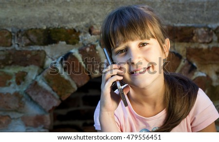 cute little girl using the phone
