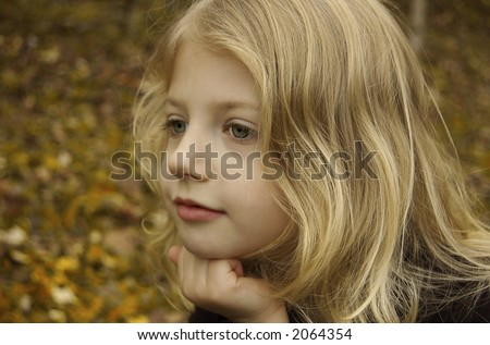 "Cute little girl version of ""The Thinker"" - stock photo"