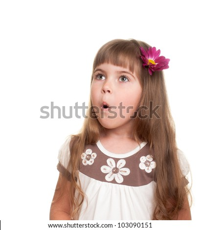 cute little girl very surprised and looking up somewhere with bud of chrysanthemum in hair against white background - stock photo