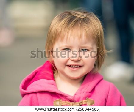cute little girl walking on the street - stock photo