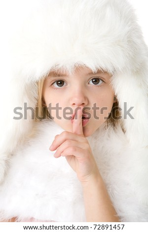 cute little girl weaing a white fur coat and hat isolated on white background