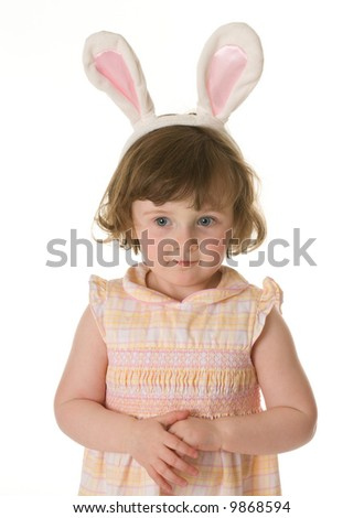 Cute Little Girl Wearing a Pair of Bunny Ears for Easter - stock photo