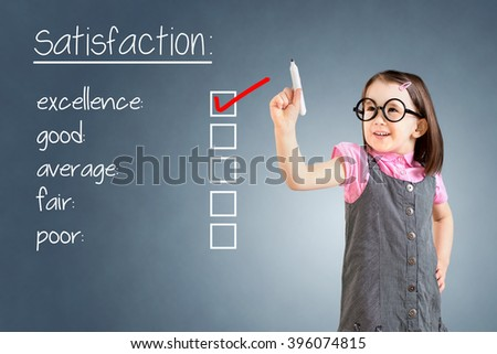 Cute little girl wearing business dress and checking excellence on customer satisfaction survey form. Blue background.