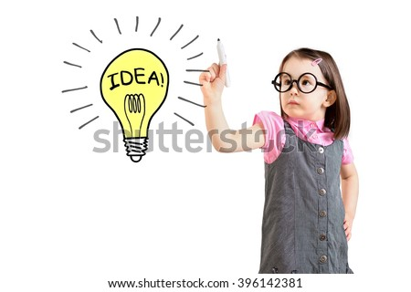 Cute little girl wearing business dress and drawing a light bulb. White background.