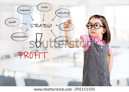 Cute little girl wearing business dress and writing a schema at the whiteboard with ideas for a good strategy to make profit. Office background. - stock photo