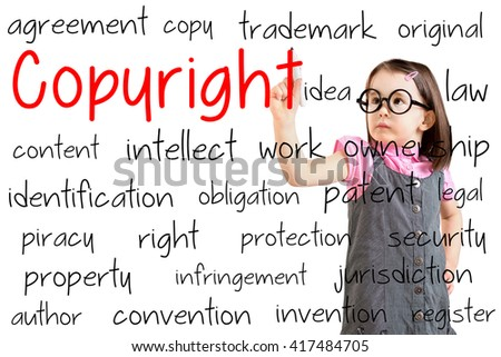 Cute little girl wearing business dress and writing copyright concept. White background. - stock photo