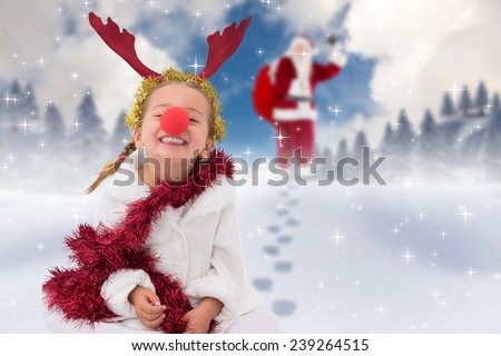 Cute little girl wearing red nose and tinsel against blue sky with white clouds - stock photo