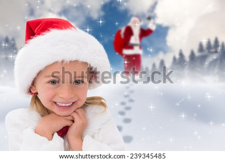 Cute little girl wearing santa hat against blue sky with white clouds - stock photo