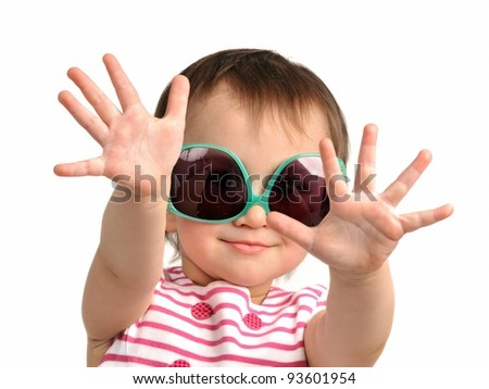 Cute little girl wearing sunglasses isolated - stock photo