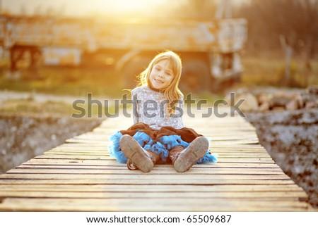 Cute little girl wearing tutu skirt - stock photo