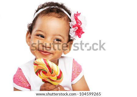 Cute little girl with a big lollipop - stock photo