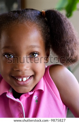 Cute Little Girl With a Big Smile and Eye Contact - stock photo