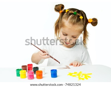 cute little girl with a brush and paints