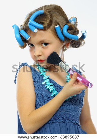 cute little girl with a brush Make-up - stock photo