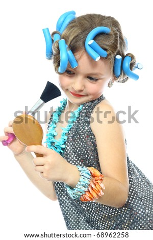 cute little girl with a brush Make-up and mirror - stock photo