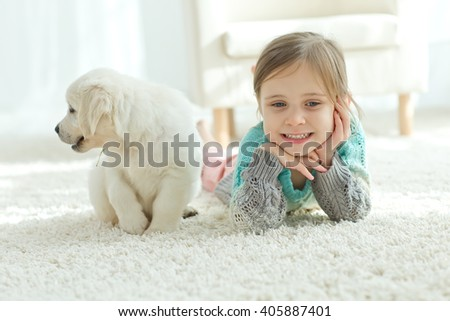 Cute little girl with a dog with love, smiling. - stock photo