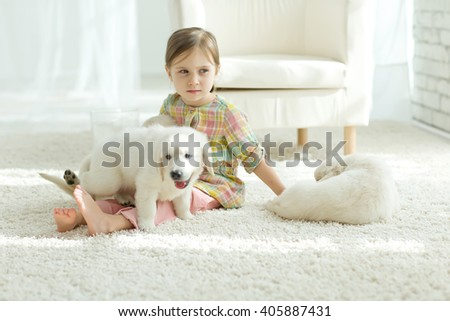 Cute little girl with a dog with love, smiling.