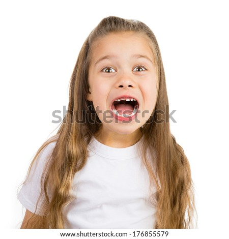 Cute little girl with a few missing teeth smiling - stock photo