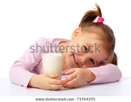Cute little girl with a glass of milk, isolated over white - stock photo